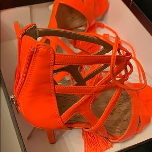 Neon orange heels. String up with tassels